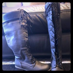 Tall combat style boot